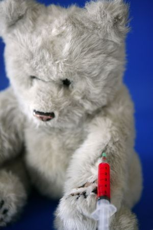 inject: Teddy bear on the doctor, with bloody vaccine syringe on its arm