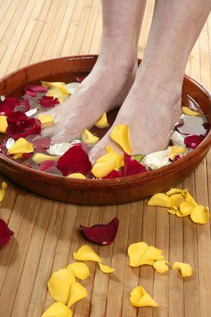 Aromatherapy, flowers woman feet bath, colorful rose petal Stock Photo - 4698105