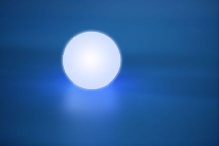 Abstract glowing light sphere over blue background photo