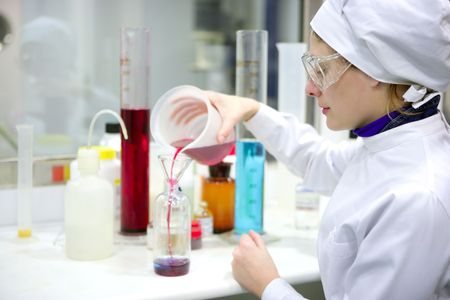Chemical research laboratory, woman working, glass cylinder vase Stock Photo - 4785727