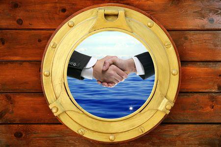 Businessmen seascape handshake view from boat round window photo
