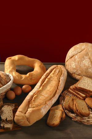 Bread still live over dark wood background, varied shapes Stock Photo - 4849817