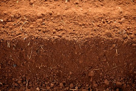 Ploughed red clay soil agriculture fields ready to sow photo