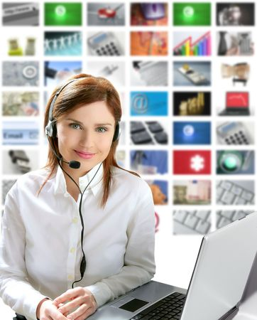 video call: Business redhead beautiful woman headset micro headphones tech helpdesk Stock Photo