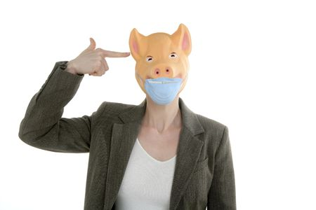 Swine flu metaphor, woman with piggy mask and finger gun photo