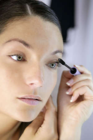 Beautiful woman portrait on the mirror with eye self makeup Stock Photo - 4905799