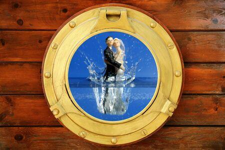 Couple sea wedding trip figure boat window view jumping to the water metaphor photo