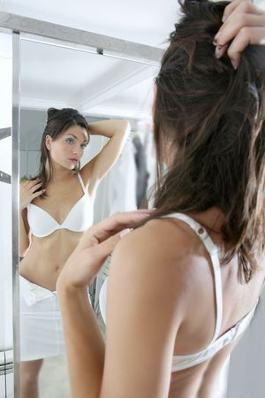 Beautiful y young woman posing on the mirror Stock Photo - 4938675
