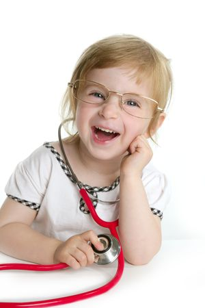 work heart: Cute little girl pretending to be a doctor with stethoscope over white