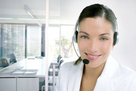 Headset phone business woman dress in white studio shot photo