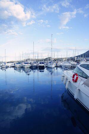 Beautiful blue marina in Mediterranean sea with sky reflection on sea photo