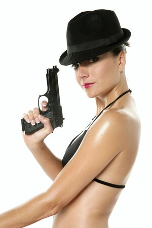 Beautiful sexy bikini woman with black gun isolated on white photo