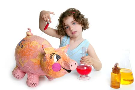 Little girl pretending to be a veterinary with a pig, AH1N1 flu photo
