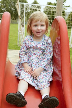 Beautiful toddler blond girl playing on the park playground Stock Photo - 5060006