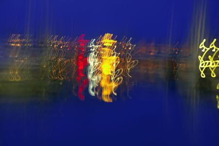 Abstract night blurry colorful lighs in movemet over blue background photo