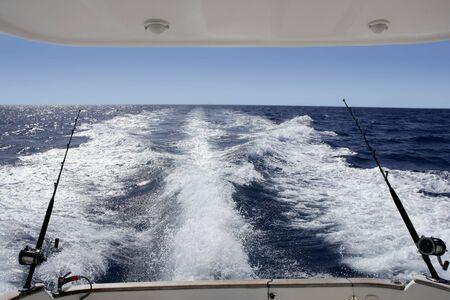 Fishing big game tuna boat with rod and reels photo