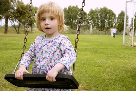 Beautiful toddler blond girl playing on the park playground Stock Photo - 5140497