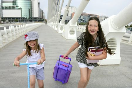 going: Little girls going to school with bags, books and student stuff