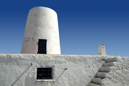 Balearic islands architecture white mill in Formentera over blue sky photo
