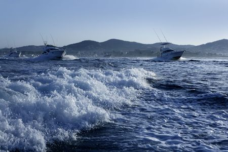 Fishing boat in a big game summer blue morning in Mediterranean sea photo