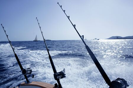 fishing pole: Fishing big game tuna boat with rod and reels in Ibiza