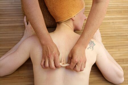 Beautiful woman receiving a back massage over bamboo spa Stock Photo - 5157572