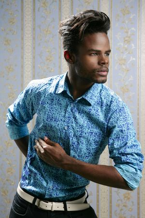 African american fashion model portrait on blue wallpaper background photo