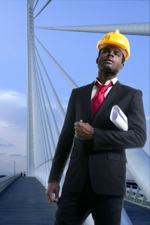 hardhat: African american architect engineer with yellow hardhat and plans