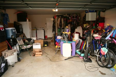 untidy: messy abandoned garage full of stuff, chaos at home