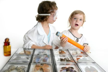 naturalist: Naturalist little girls playing with big pencil and butterfly collection