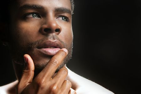 adolescent african american: African american cute black young man closeup portrait