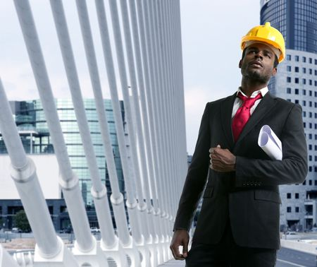 sexy construction worker: African american architect engineer with yellow hardhat and plans