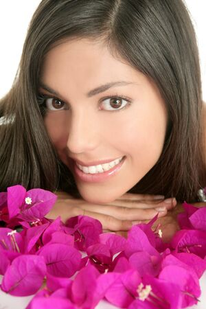 Beautiful indian woman portrait with boungainvilleas flowers over white photo
