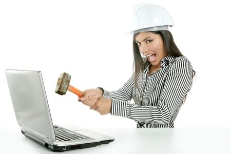 Angry brunette businesswoman with hammer against screen photo