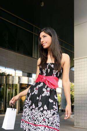 indian summer: Beautiful brunette shopaholic outdoor modern city urban street