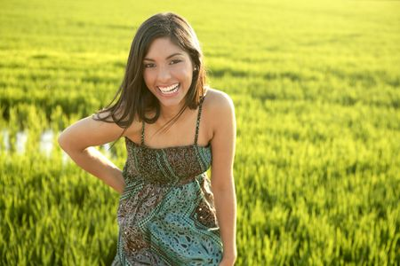 Beautiful brunette indian young woman in the green rice fields meadow photo