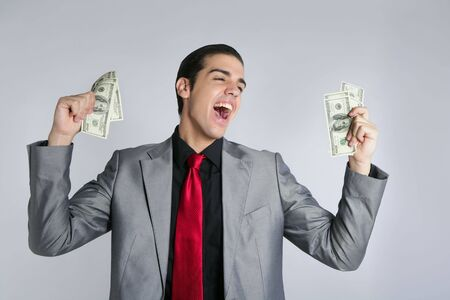 Businessman young with dollar notes suit and tie on gray background Stock Photo - 5258275