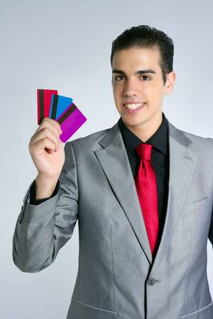Businessman young with three credit cards in his hand Stock Photo - 5258264