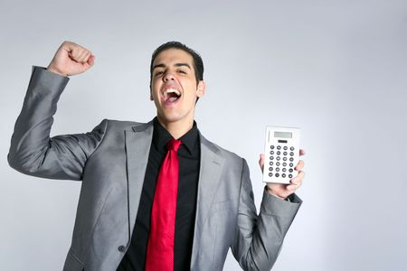 Calculator give good results to young businessman on gray background photo