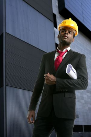 African american architect engineer with yellow hardhat and plans Stock Photo - 5285428