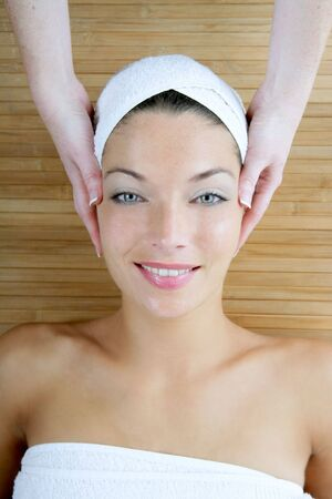 Head massage over bamboo, beautiful blue eyes woman Stock Photo - 5290808