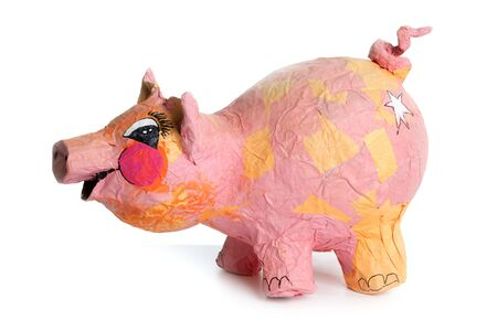 Cute little pink pig cartoon handmade toy isolated on white photo