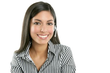 Beautiful young businesswoman talking with headset phone over white background photo