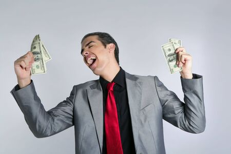 Businessman young with dollar notes suit and tie on gray background Stock Photo - 5285970