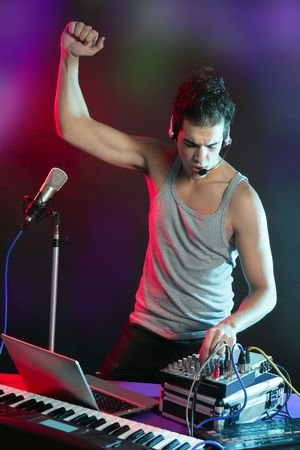 dj mixer: Dj with colorful light and music mixing digital equipment Stock Photo
