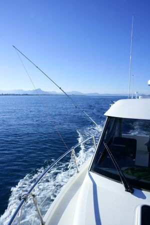 Boat white bow, yatch vacation on the blue ocean, nautical symbol photo