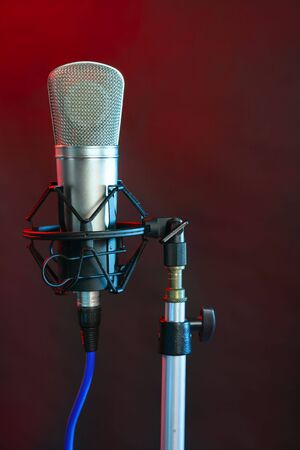 Microphone in the night colorful light in a recording studio photo