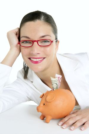Beautiful businesswoman with piggybank  over white background photo