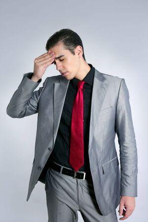 Businessman worried headache stressed and sad by work Stock Photo - 5402398