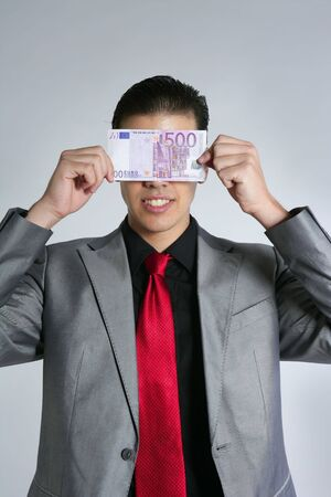 Formal young businessman portrait with 500 euro note on gray background photo